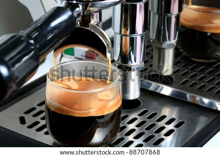 espresso, extraction from coffee machine - stock photo