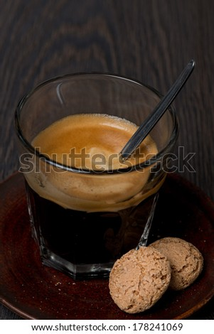 espresso in a glass and amaretti almond cookies, close-up - stock photo