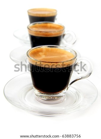 Espresso in a transparent cups on the white background - stock photo