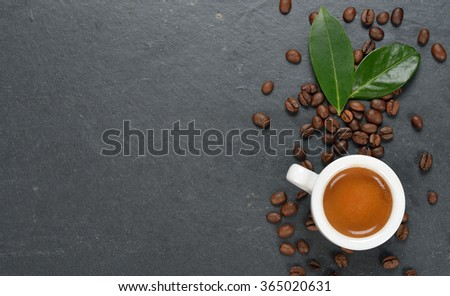 Espresso in a white cup on a black background - stock photo