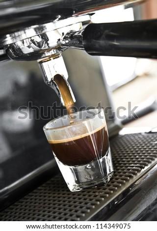 Espresso machine brewing a espresso - stock photo