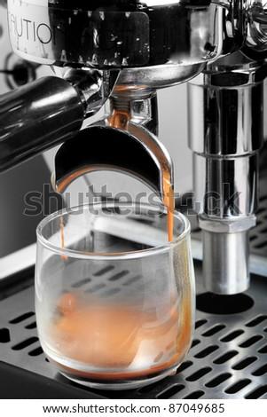 espresso machine brewing coffee to cup - stock photo