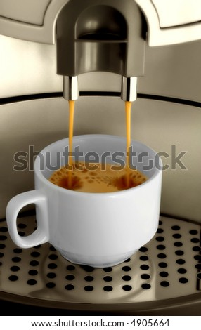 Espresso machine pouring espresso into a cup - stock photo