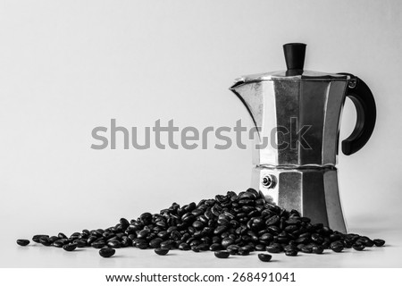 Espresso pot and coffee beans with black and white image as a vintage style - stock photo