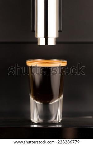 Espresso shot from exclusive coffee machine - stock photo
