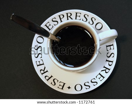espresso with spoon handle sticking out of cup - stock photo