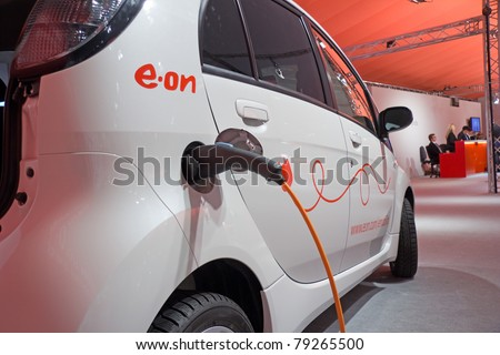 ESSEN, GERMANY - MAY, 5: An electric-car is charged at an E.ON-energy-service-station, shown on the General Meeting of Shareholders, May 5, 2011 in Essen, Germany - stock photo