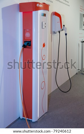 ESSEN, GERMANY - MAY, 05: - Two Prototypes of energy-service-stations, built to charge electric-cars, are shown on E.ON's annual general meeting on May 5, 2011 in Essen, Germany. - stock photo