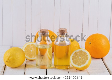 Essential aroma oil with citrus on wooden background. Selective focus. - stock photo