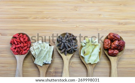 Essential chinese herbal ingredients for cooking chinese soup. From left: Chinese Wolf-berries (Gou Ji Zi),  Astragalus root (Huang Qi), Star anise, Solomon Rhizome (Yu Zhu Pian), Red dates (Hong Zao) - stock photo