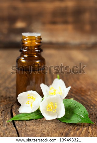 essential oil and blooming jasmine for aromatherapy