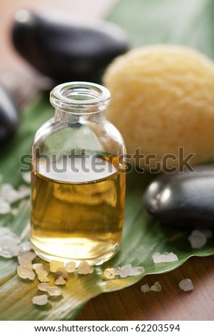 essential oil and stones - stock photo