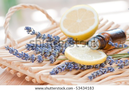 Essential oil arrangement with lemon and lavender - stock photo