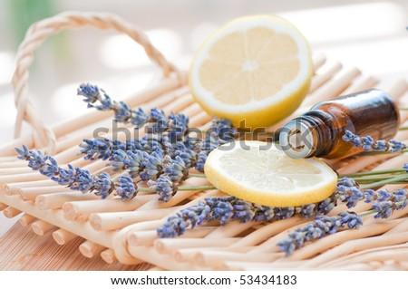 Essential oil arrangement with lemon and lavender - stock photo