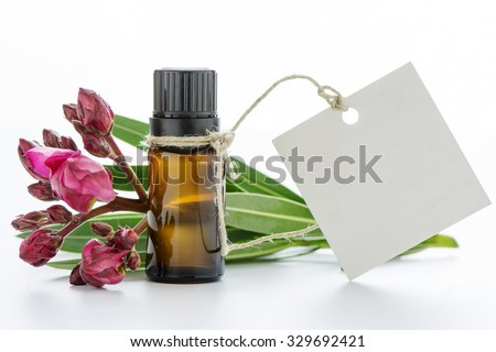 Essential oil, empty tags and roses flowers - stock photo