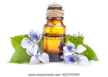 Essential oil made from violet on a white background
