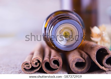 Essential oil with cinnamon - stock photo