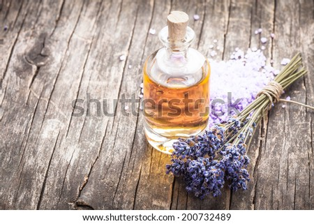 essential oil with lavender flower and seasalt - spa concept - stock photo