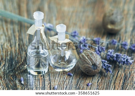 essential oil with lavender flowers and nutmeg - stock photo