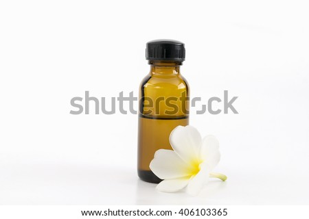 Essential oil with plumeria flower on a white background. - stock photo