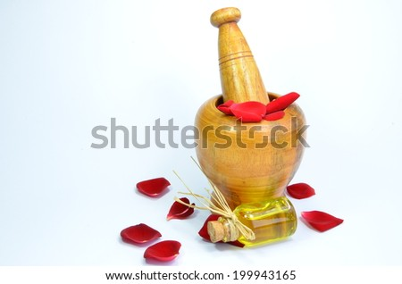 Essential oil with rose petals on a white background  - stock photo
