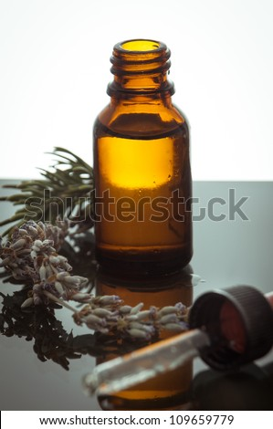 essential oil with rosemary and lavender - stock photo