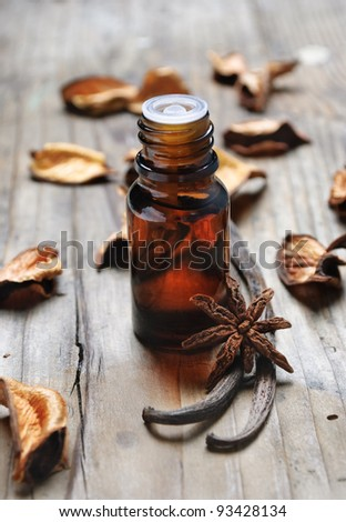 Essential oil with vanilla and anise seed - stock photo