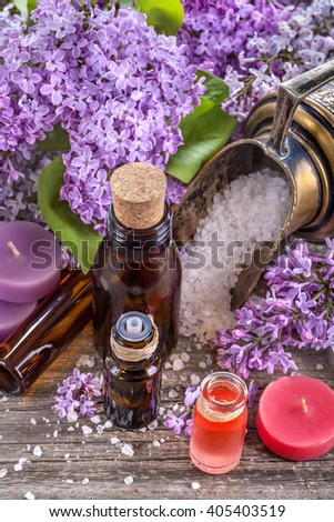 Essential oils and bath salt with a background of lilac - stock photo