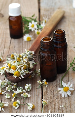 Essential oils and herbs - stock photo