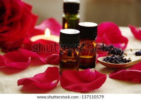 essential oils for aromatherapy treatment with rose - stock photo