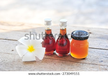 Essential oils from coconut on wooden table. - stock photo