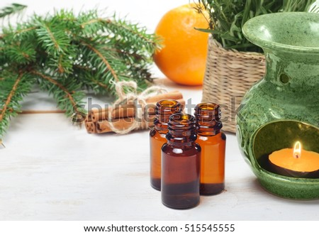 Essential oils in glass bottles  on wooden background with copyspace