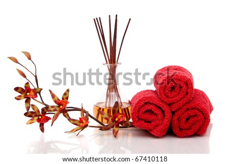 Essential oils, spa towels and orchid - stock photo