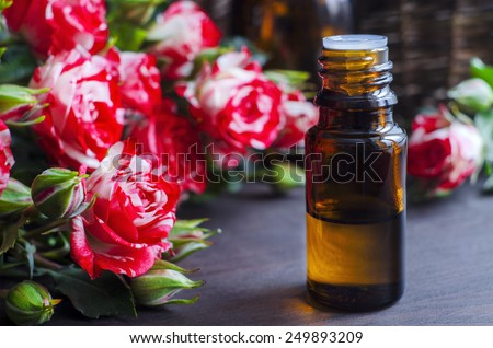 Essential rose oil - stock photo