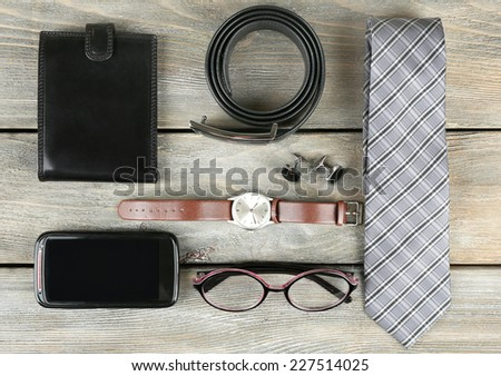 Essentials fashion man objects on wooden background - stock photo