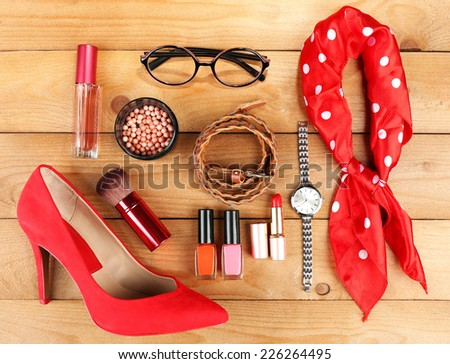 Essentials fashion woman objects on wooden background - stock photo