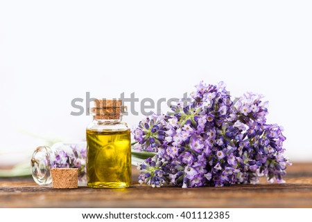 Essentials oils with lavender flowers. Wellness still-life. - stock photo