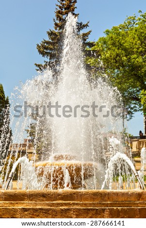ESSENTUKI, RUSSIA - MAY 22 2015: Fountain at the Kurortniy (Glavny) Park entrance. The park is the main tourist attraction. - stock photo
