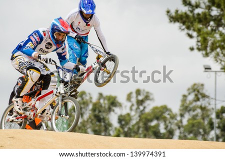 ESTARREJA, PORTUGAL - MAY 26: Carlos Rosado, on the left, leading the race at the 2nd Portugal Bmx Open on may 26, 2013 in Estarreja, Portugal.