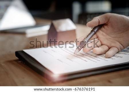 estate agent gives pen and documents agreement with customer to sign contract. Concept agreement