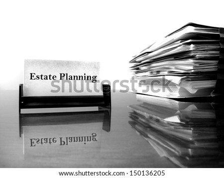 Estate Planning business card on desk with files - stock photo