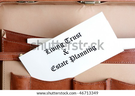 Estate planning documents in a leather briefcase - stock photo