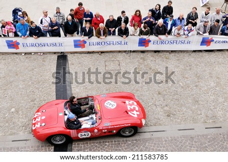 ESTE (PD), ITALY - MAY 16: A red Maserati 150S takes part to the 1000 Miglia classic car race on May 16, 2014 in Este. The car was built in 1955 - stock photo
