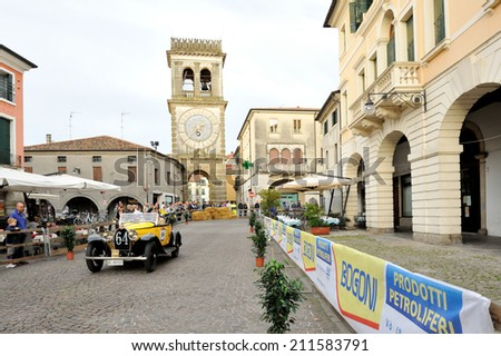 ESTE (PD), ITALY - MAY 16: A yellow Bugatti T40 takes part to the 1000 Miglia classic car race on May 16, 2014 in Este. The car was built in 1930 - stock photo