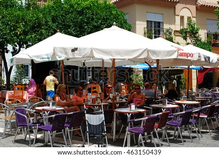 ESTEPONA, SPAIN - JULY 18, 2008 - People relaxing at pavement cafes in the old town, Estepona, Malaga Province, Andalucia, Spain, Western Europe, July 18, 2008.