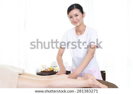 Esthetician to the treatment - stock photo