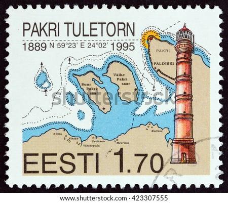 ESTONIA - CIRCA 1999: A stamp printed in Estonia shows Pakri Lighthouse and nautical chart, circa 1999.  - stock photo