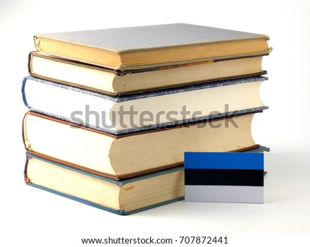 Estonia flag with pile of books isolated on white background
