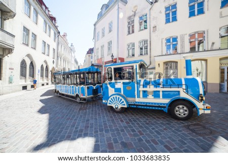 ESTONIA - JULY 22, 2017: Tourist train car on the street of old Tallinn, circa 2017