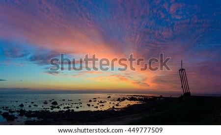 Estonia Memorial with sunset sky, island of Hiiumaa, Estonia. - stock photo